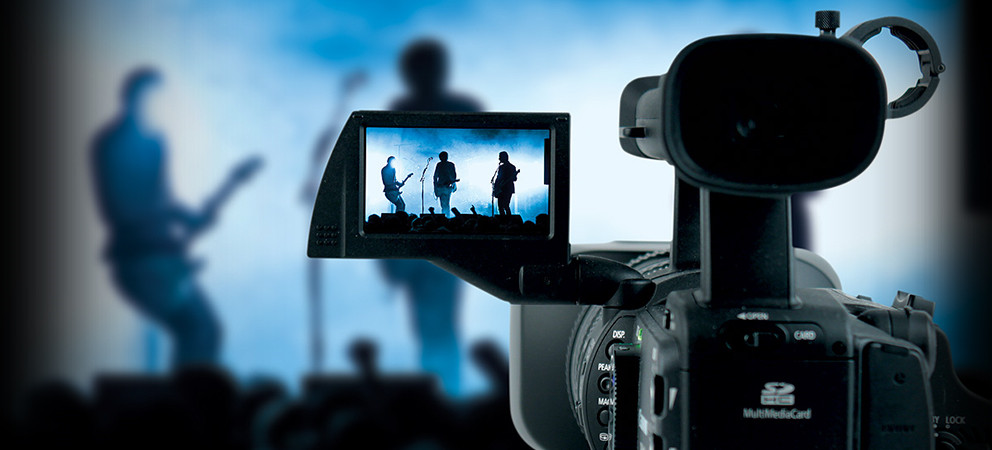 The filming of a music concert