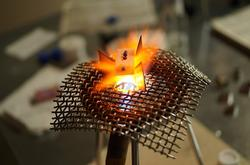 An image of a common method of enameling called torch fire