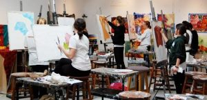 An image of college students painting