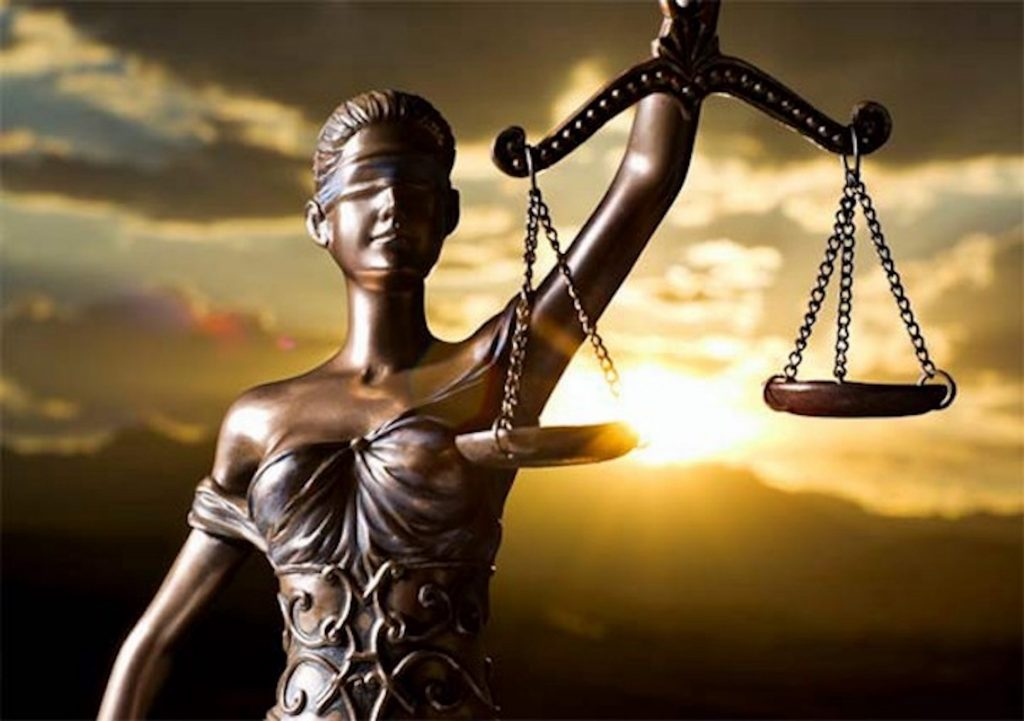A symbol of justice depicted through scales balancing the aims of criminal law
