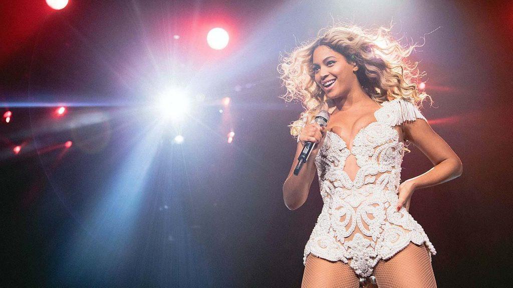 An image of Beyoncé performing in concert.