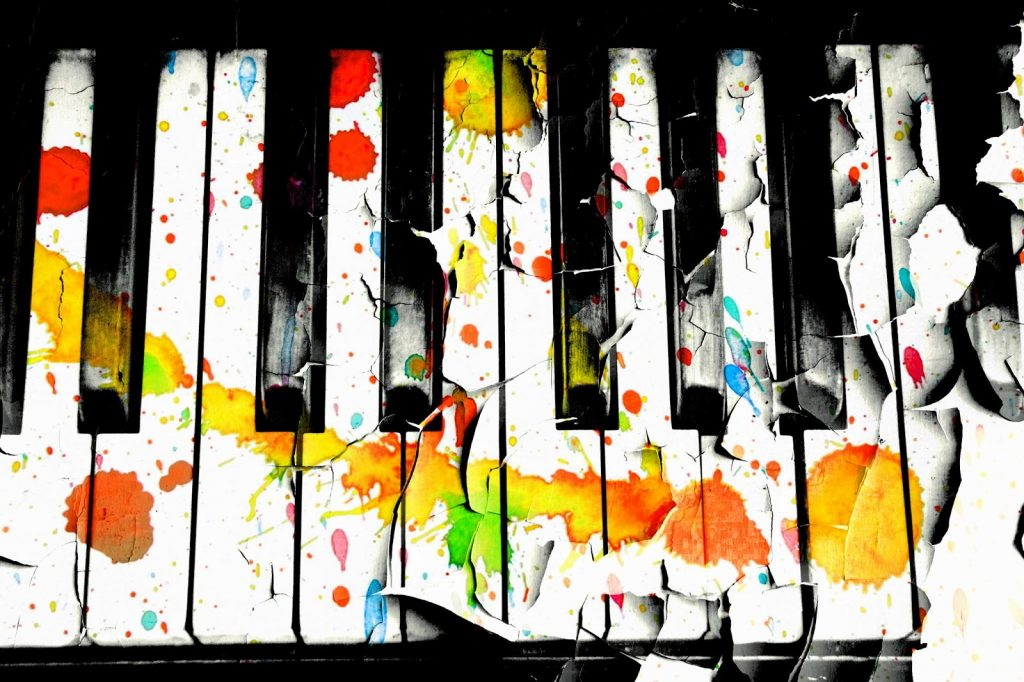 Paint splattered on a piano.