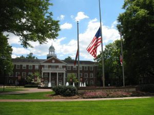Flags at half mast in front of Alamance building