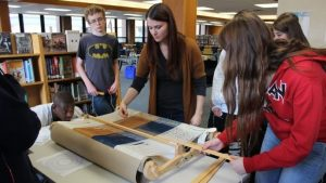 An image of students learning to weave
