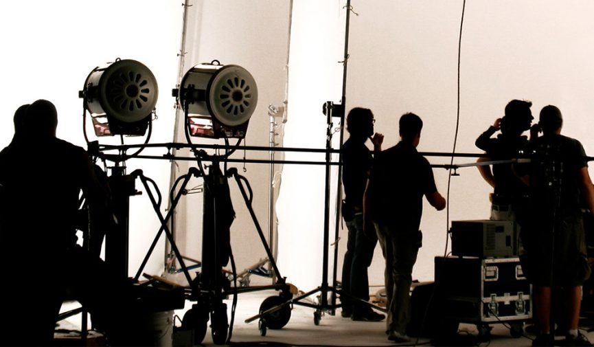 film set with cameras and workers