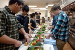 An image of college students in a cooking class