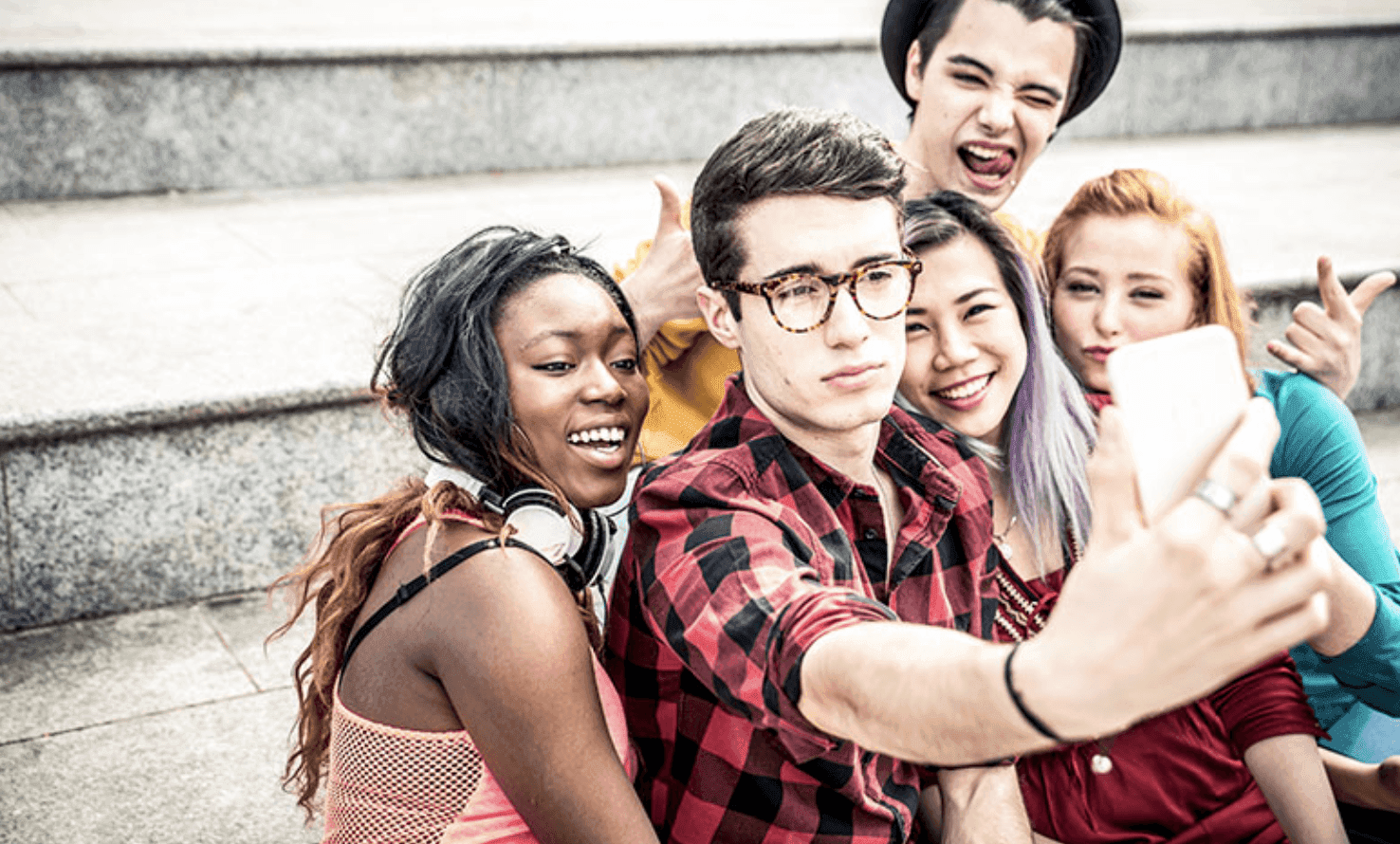 Adolescents taking a group selfie during a hangout