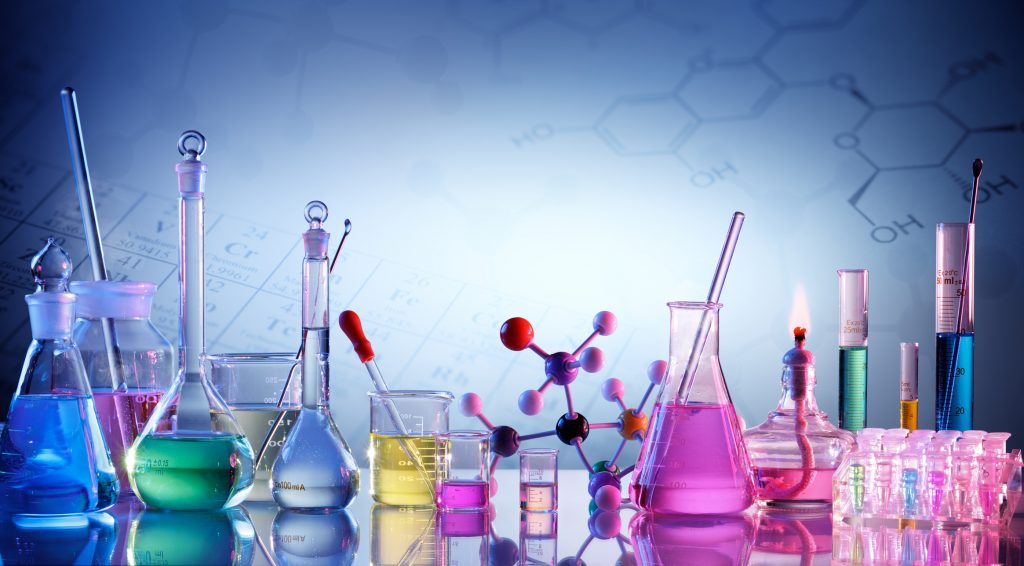 Glassware and chemicals used in chemistry labs.