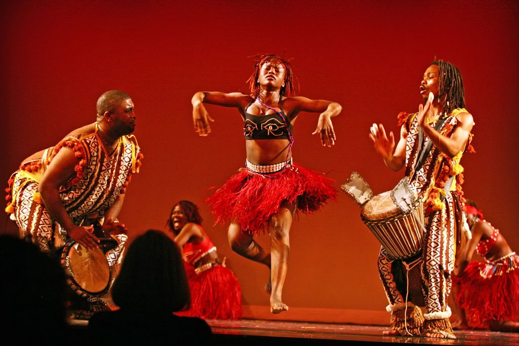 African dancers performing on stage.