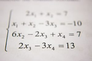 Close-up of algebra problem on paper