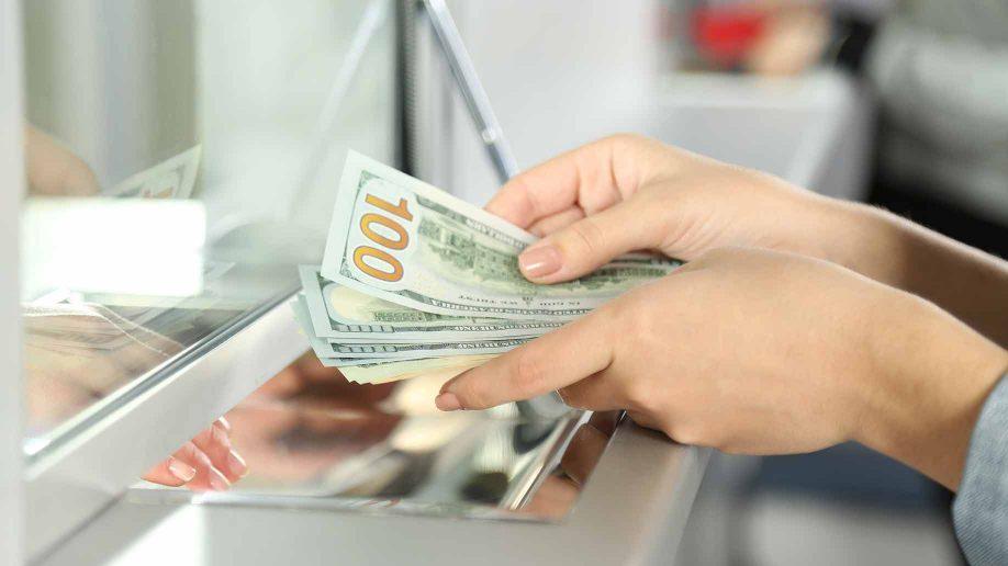 A person handling American money.