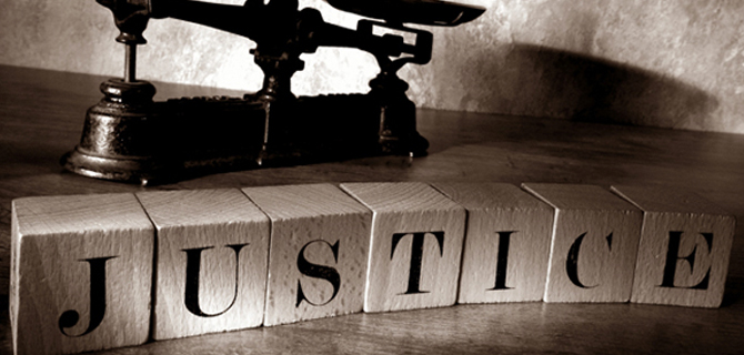 Wooden blocks spelling out 'justice'