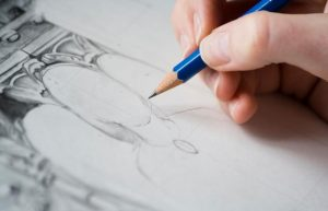Close-up of hand drawing with pencil