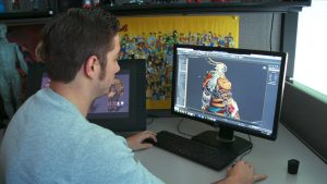 A Person designing a character on the computer