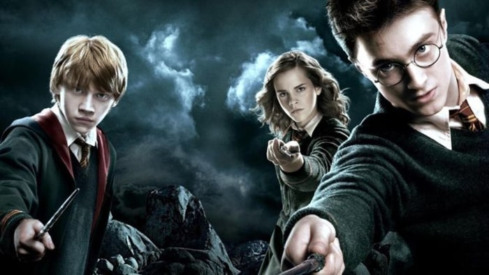 A still from Harry Potter showing Ron, Hermione and Harry
