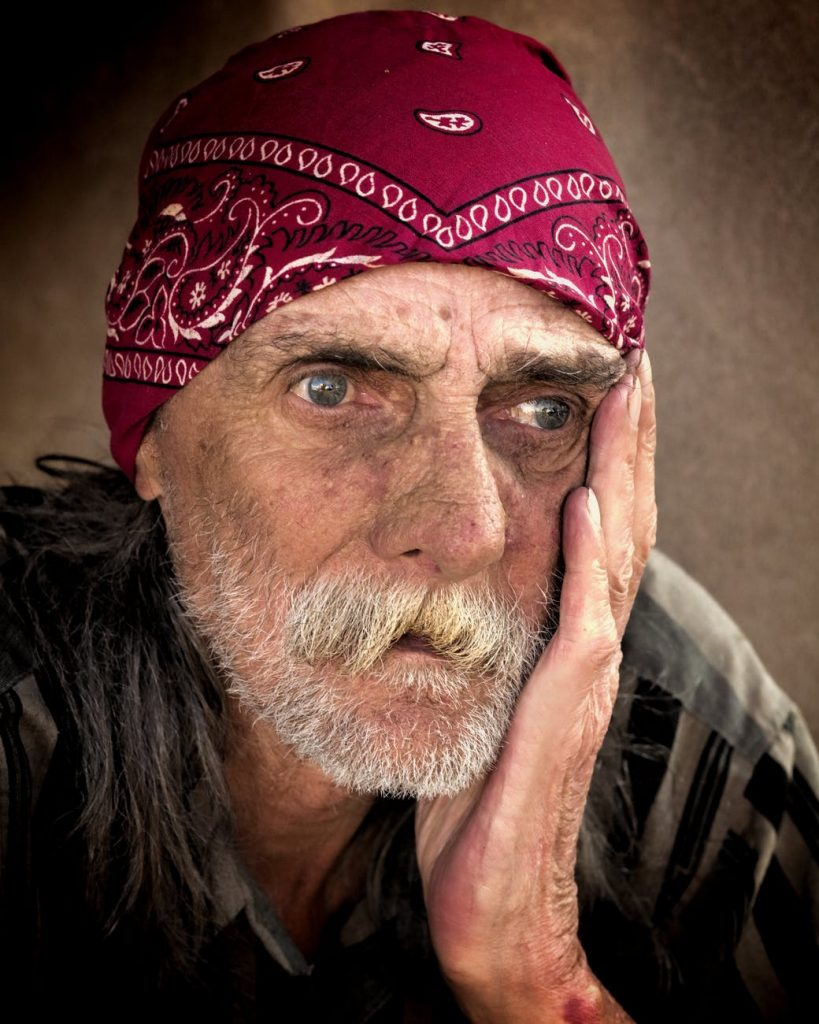 portrait of old homeless person