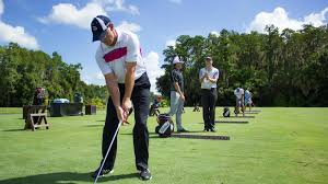 This shows a golfer work on his full swing.