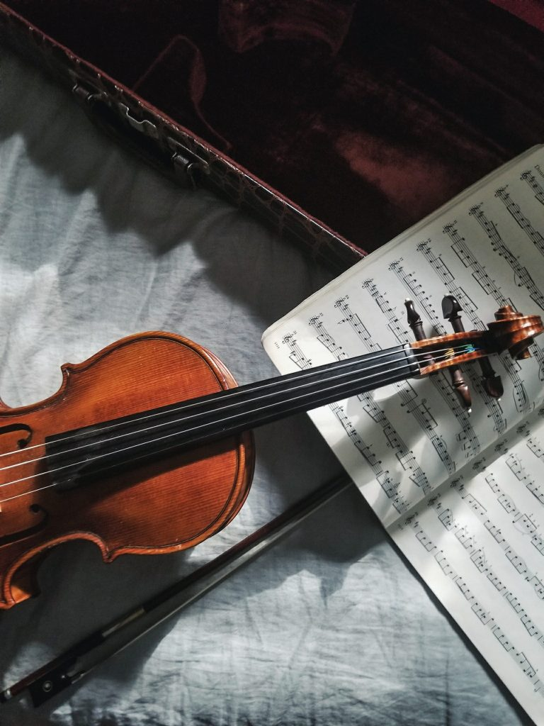 A picture of a violin and a music book