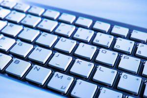 Keyboard with white keys black background