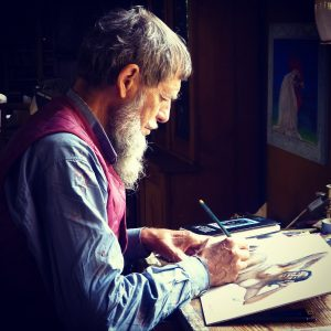 a man drawing on a pad