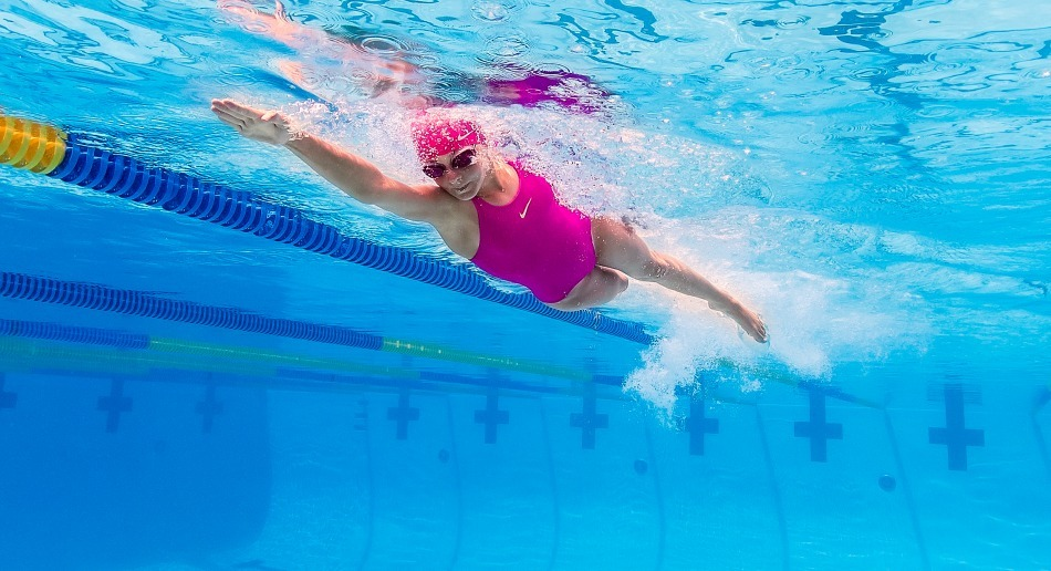 A girl swimming in a pool.
