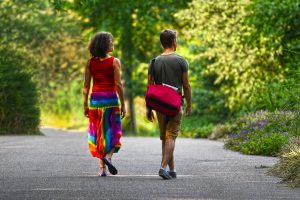 two people walking together on a road