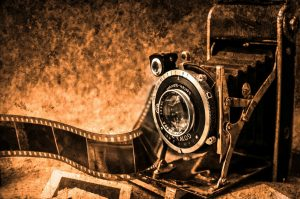 Old Camera with parchment background