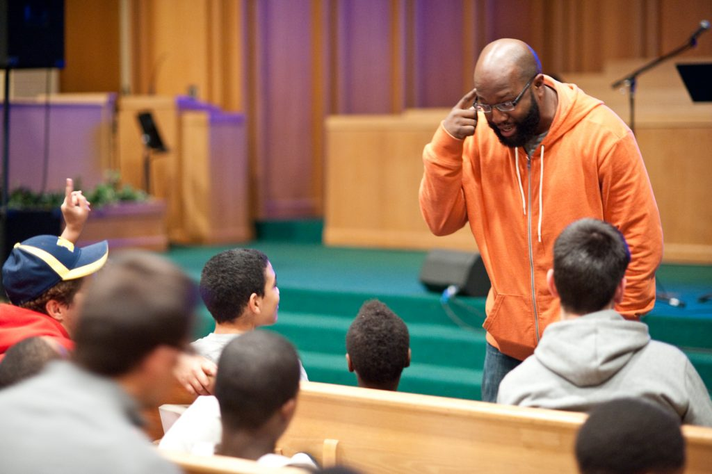 A man teaching the youth.