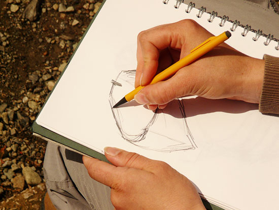 Image of a person sketching.