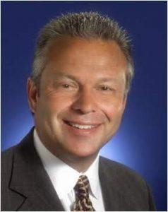 David E. Steele. Professor of Business.