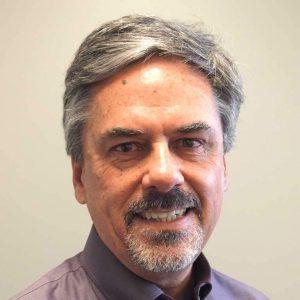 John McCormick. Professor of Politics.