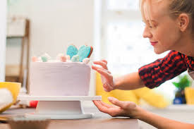 Picture of a woman decorating a cake