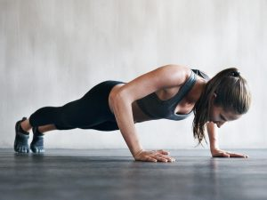 A woman doing a push-up.
