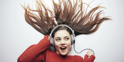 Woman listening to music on her headphones
