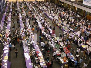 NYU Club Fest tables in a crowded hall.