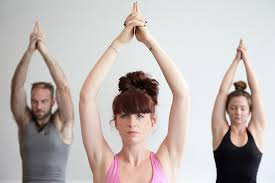 Three people in a yoga position