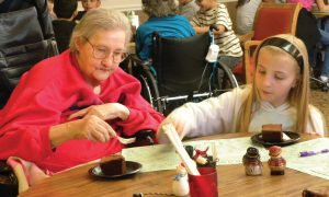 A girl working with the elderly.