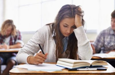 Stressed student studying