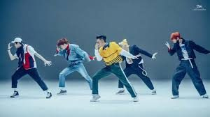 A picture of a Kpop group dancing
