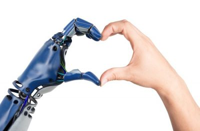Robotic hand and human hand forming a heart