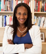This image of Professor Berhane shows her smiling in the school library.