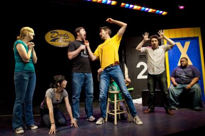 Students doing improv on stage