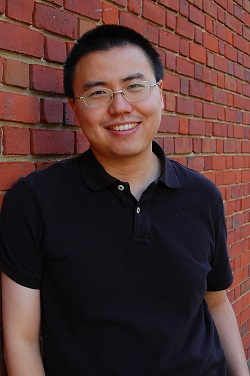 Professor Pei is seen here posing against a brick way.