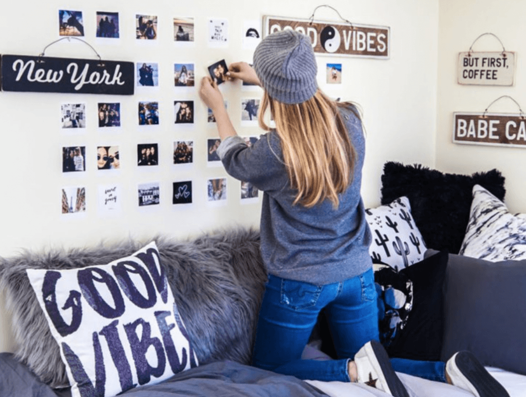a girl decorating her room