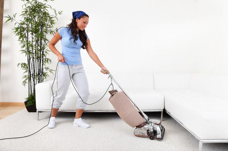 A girl vacuuming