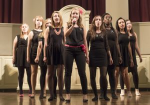 Female a capella group playing.