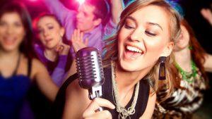 A girl singing at Karaoke Night.