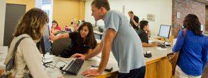 Students utilizing printing services at Mugar Library