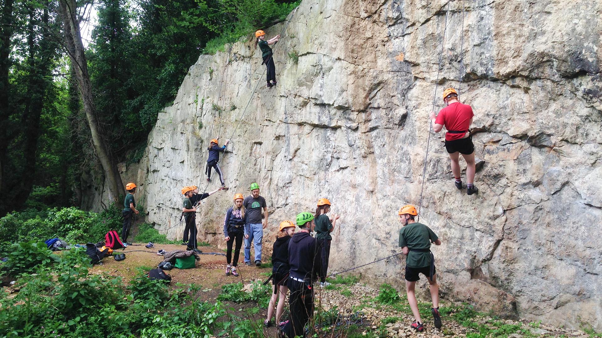 People climbing a big rock