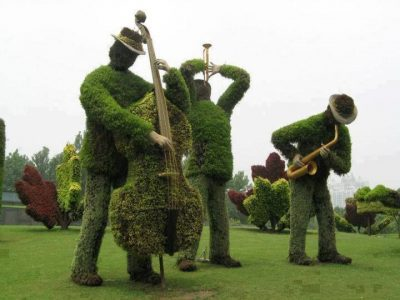 Musician and instrument shaped topiary